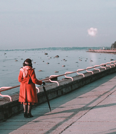 Photo of woman in front of sea. By Artyom Kabajev